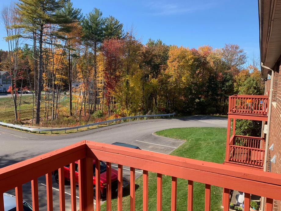 Eastern Trails apartment balcony with fall foliage view in New Hampshire