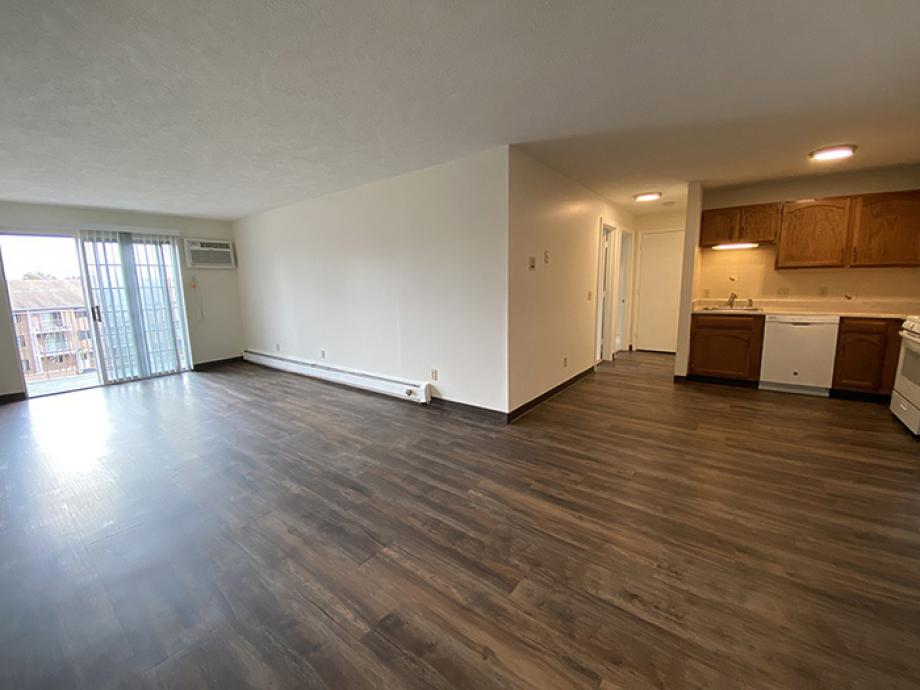 large apartment with wood floors