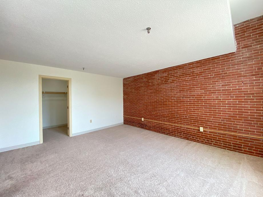 some bedrooms have brick accent walls and large walk-in closets